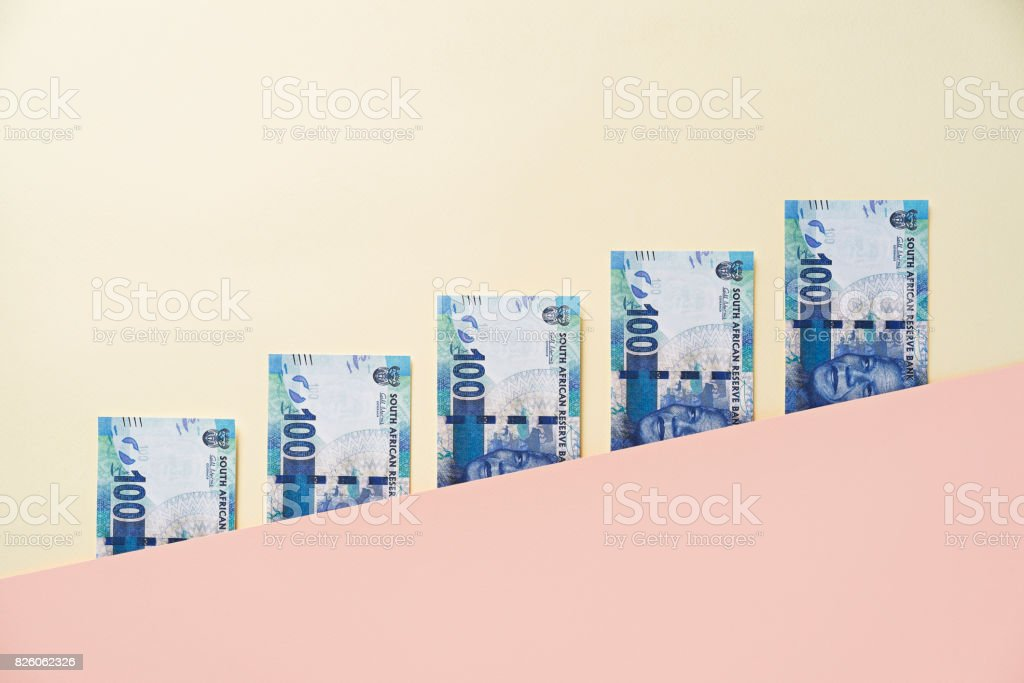 South Africa rand banknotes between diagonal pink yellow color block layers stock photo