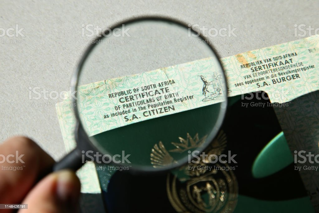 A South African birth certificate and Identity document. Home affairs concept image. A South African birth certificate and Identity document. Home affairs concept image. Africa Stock Photo