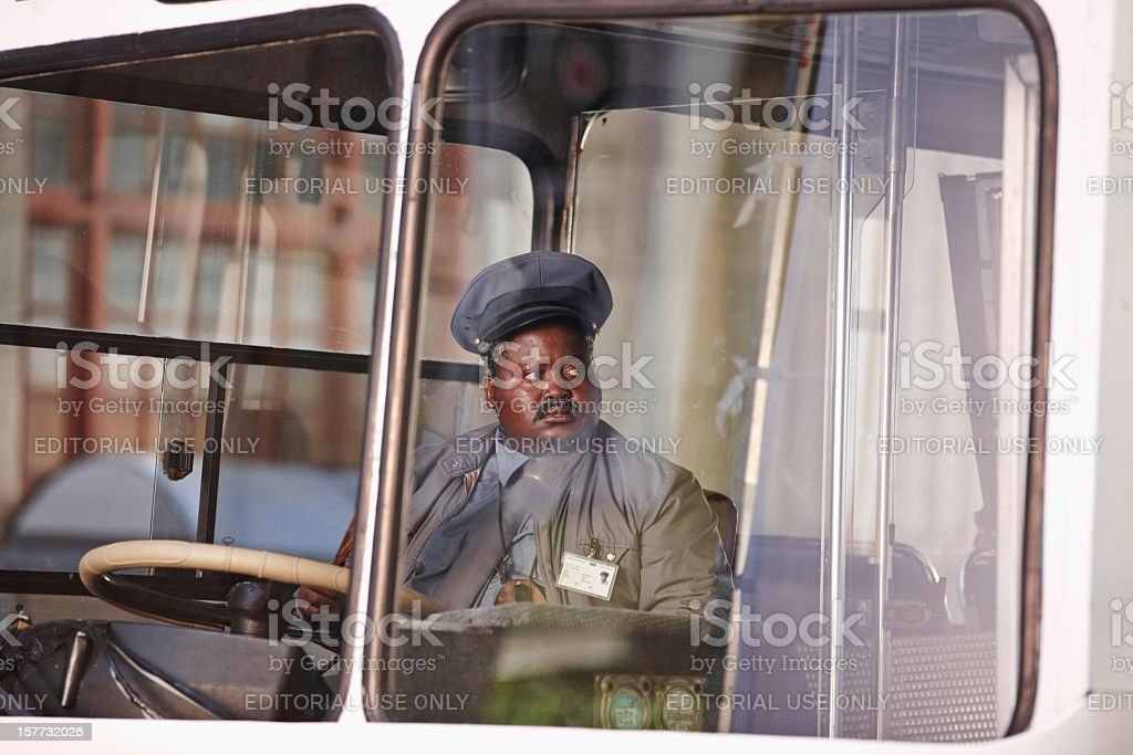 South African busdriver on white downtown bus stock photo