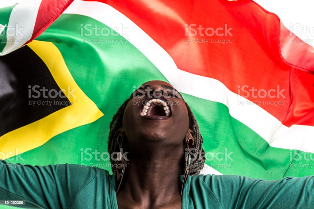 South African fan celebrating with the national flag royalty-free stock photo
