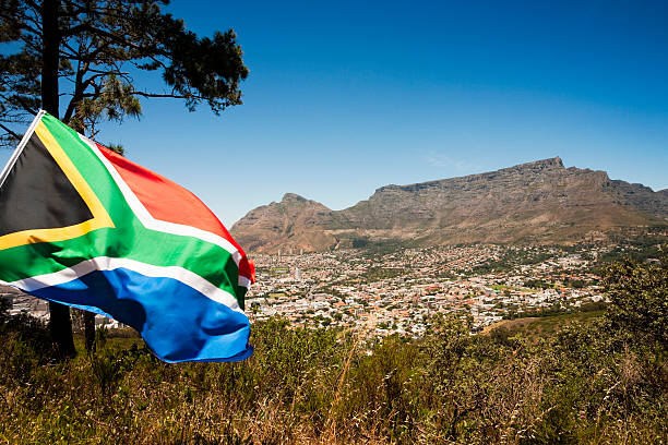 South African flag against Table Mountain, Cape Town  south africa stock pictures, royalty-free photos & images
