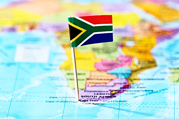 south african flag marks cape town on map of africa - cape peninsula stock pictures, royalty-free photos & images