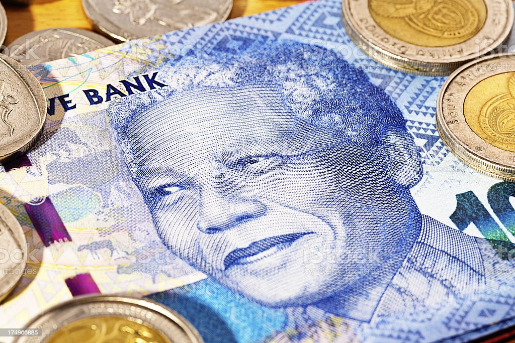 South African Hundred Rand banknote featuring Nelson Mandela with coins stock photo