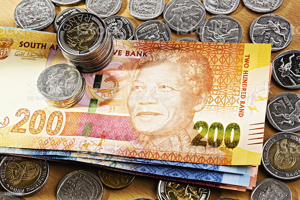 South African Mandela banknotes and silver coins stock photo
