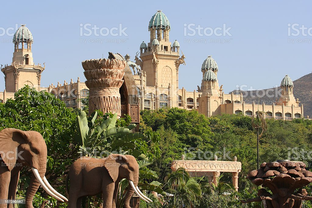 South African palace surrounded by trees and elephants royalty-free stock photo