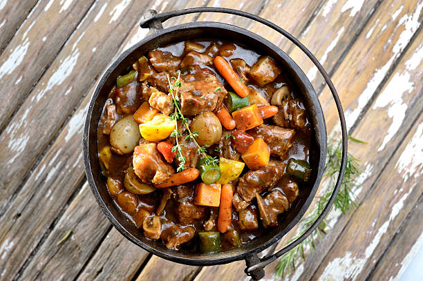 South African potjiekos top view Traditional South African pot stew or potjiekos in the three-legged pot used to cook this dish on an open fire. Usually served with rice dished with a large spoon. stew stock pictures, royalty-free photos & images