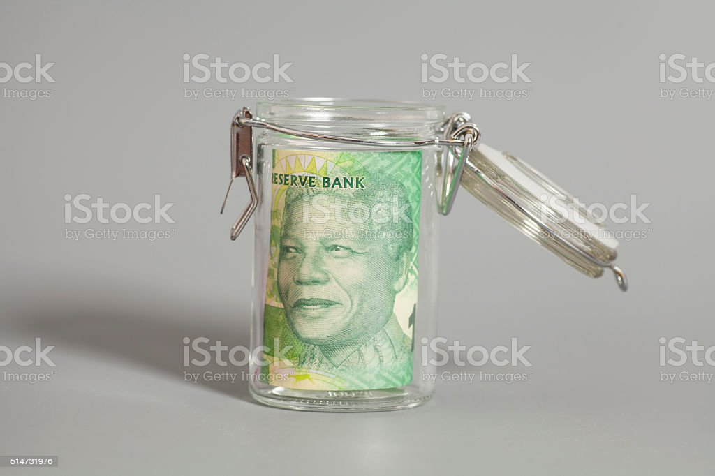 South African Rand in a glass jar stock photo