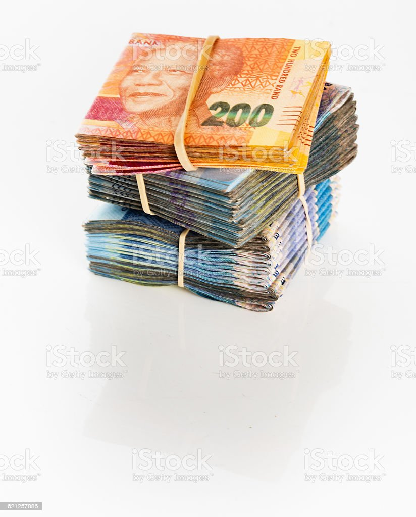South African ready cash: bundles of folded banknotes stock photo