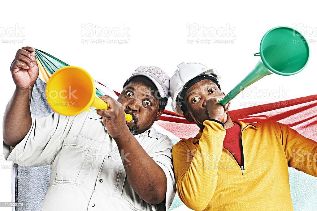 South African soccer fans blow vuvuzelas stock photo