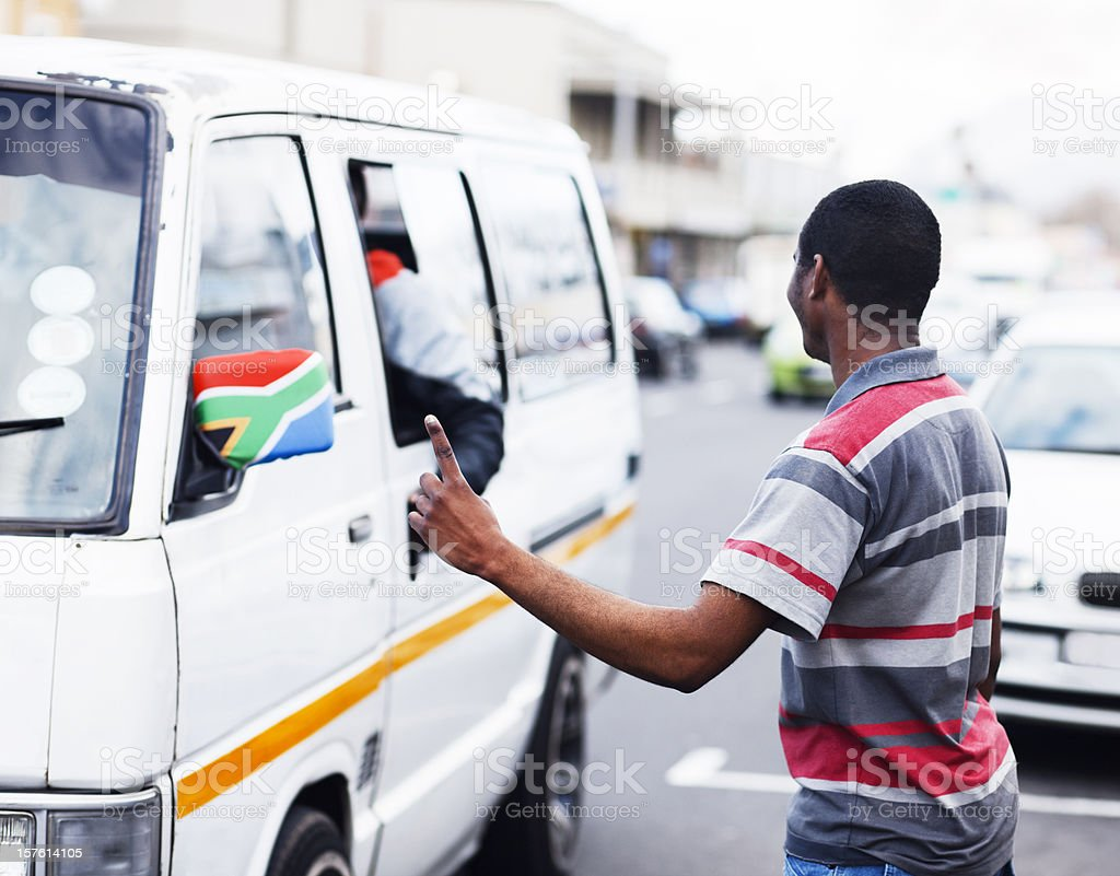 South African street scene with man signalling a taxi stock photo