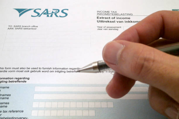 south african tax form - sars foto e immagini stock