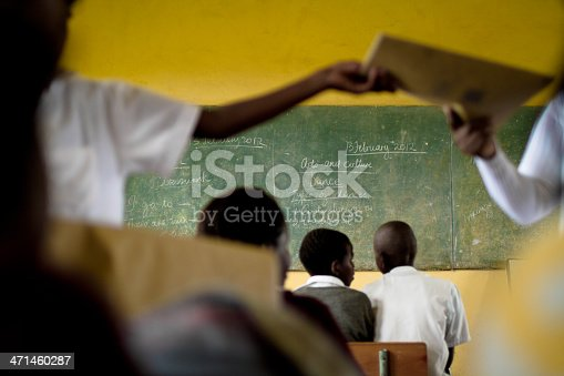 istock South African teacher hands out books in her classroom 471460287