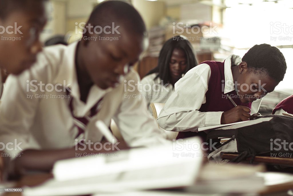 South African teenagers concentrating on an English exam stock photo
