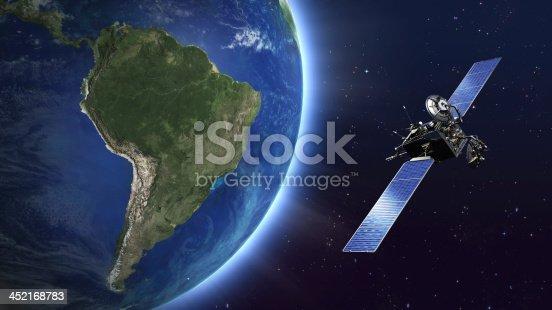 istock South America. Telecommunication satellite orbiting Earth. 452168783
