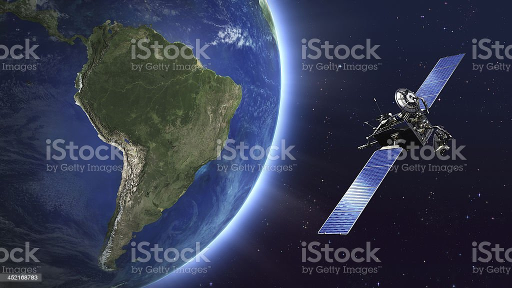 South America. Telecommunication satellite orbiting Earth. stock photo