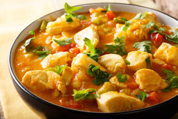 South American Food: Bobo chicken stew with vegetables in coconut milk close-up. horizontal South American Food: Bobo chicken stew with vegetables in coconut milk close-up in a bowl. horizontal stew stock pictures, royalty-free photos & images