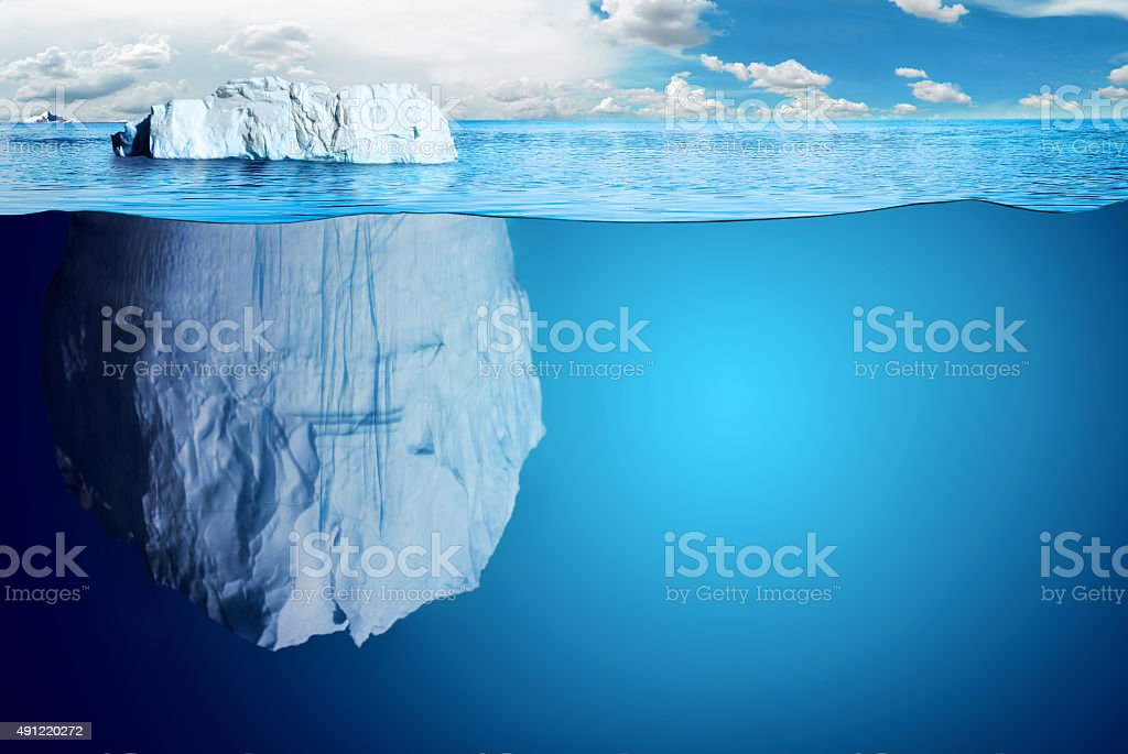 Underwater view of iceberg with beautiful polar sea on background -...