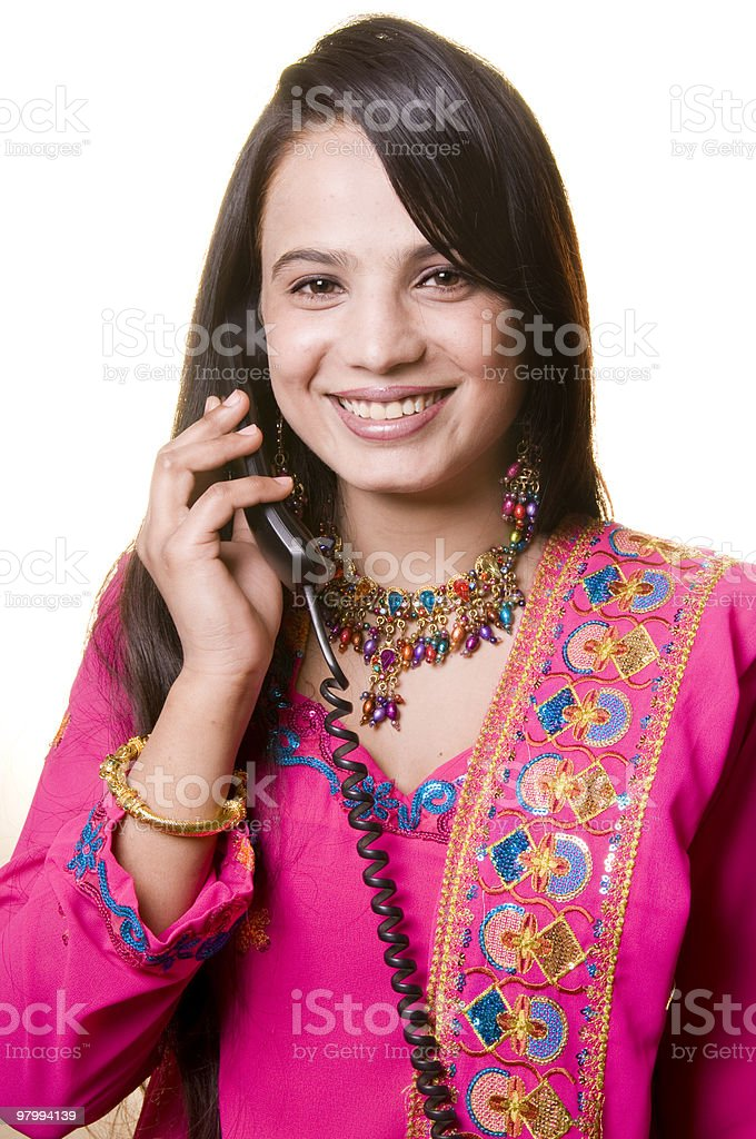 South Asian woman talking on telephone royalty-free stock photo