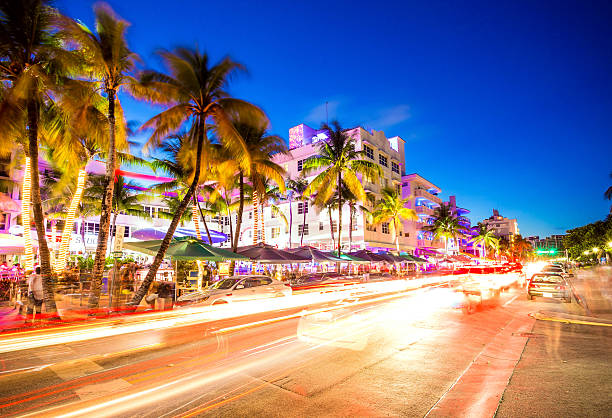 South Beach night life at Ocean Drive, Miami, USA Ocean Drive scene at night lights, cars and people having fun, Miami beach. La noche de Ocean Drive en Miami Beach, Florida, Estados Unidos. miami beach stock pictures, royalty-free photos & images