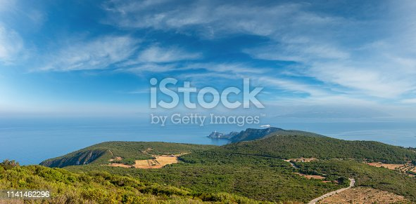South cape of Lefkas island and lighthouse panorama (Lefkada, Greece, Ionian Sea). View from up.