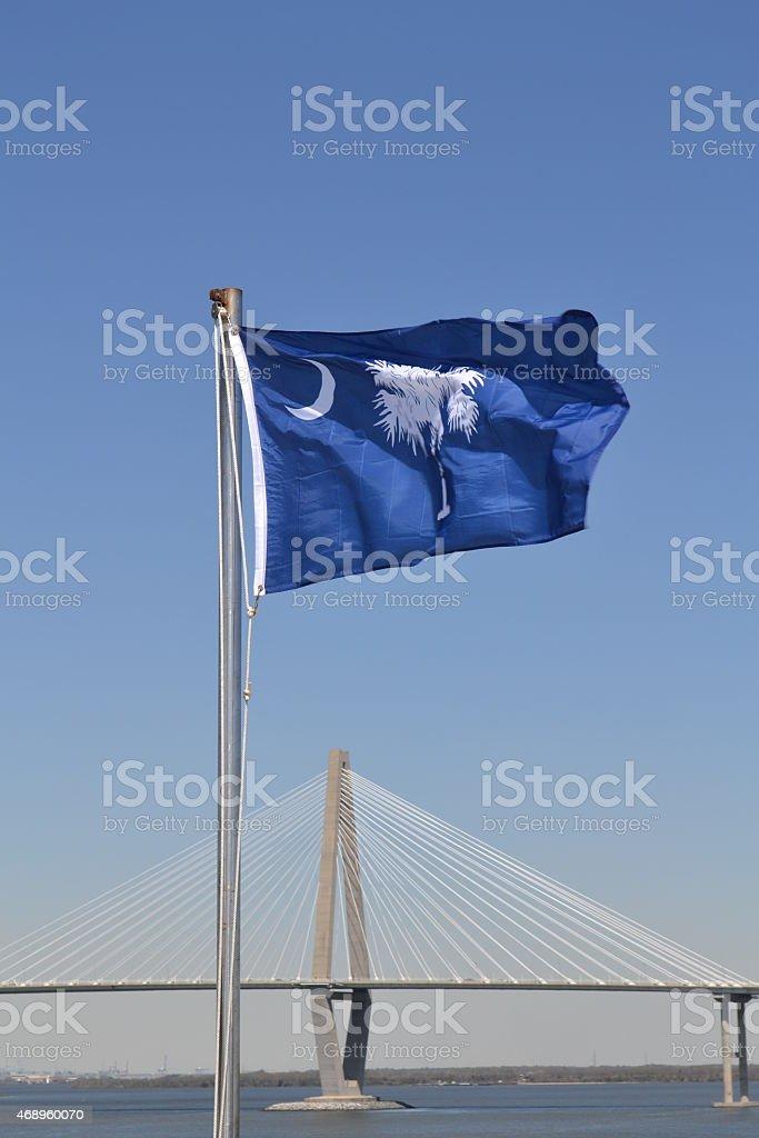 South Carolina Flag in Front of the Bridge to Charleston stock photo
