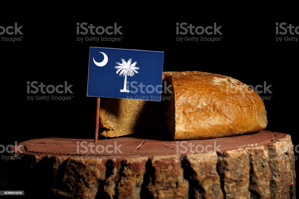 South Carolina flag on a stump with bread isolated stock photo