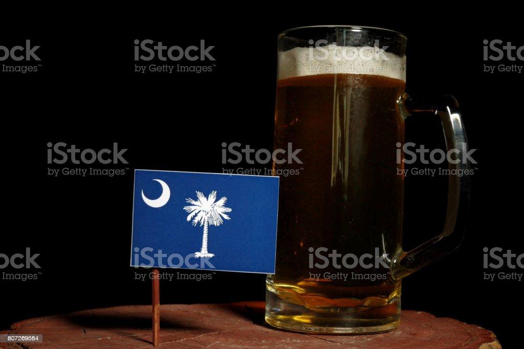 South Carolina flag with beer mug isolated on black background stock photo