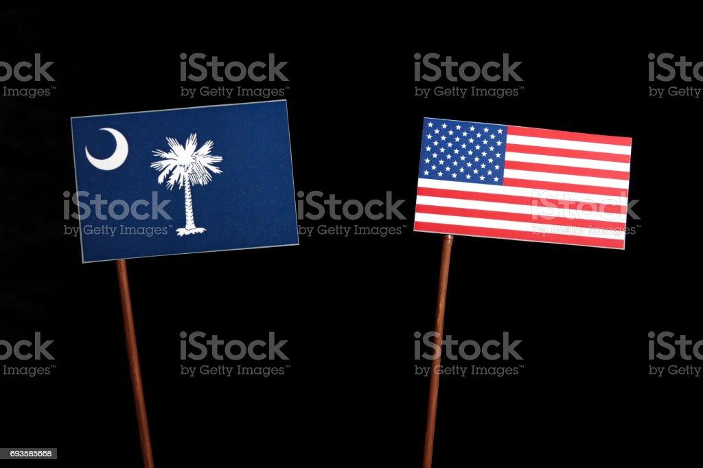 South Carolina flag with USA flag isolated on black background stock photo