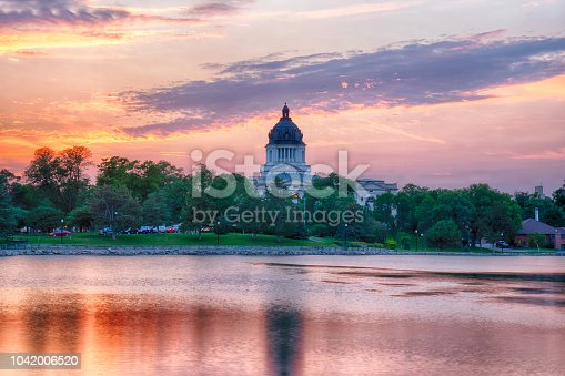 PIERRE, SD - JULY 9, 2018: South Dakota Capital Building along Capitol Lake in Pierre, SD at sunset
