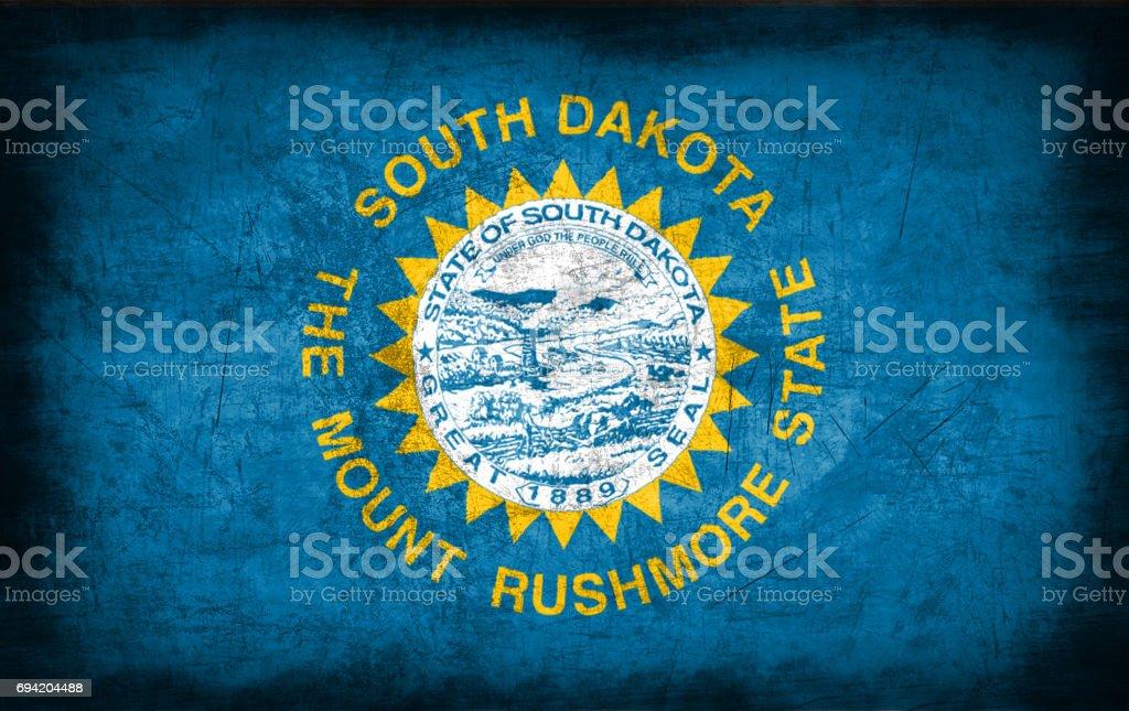 South Dakota flag with grunge metal texture stock photo