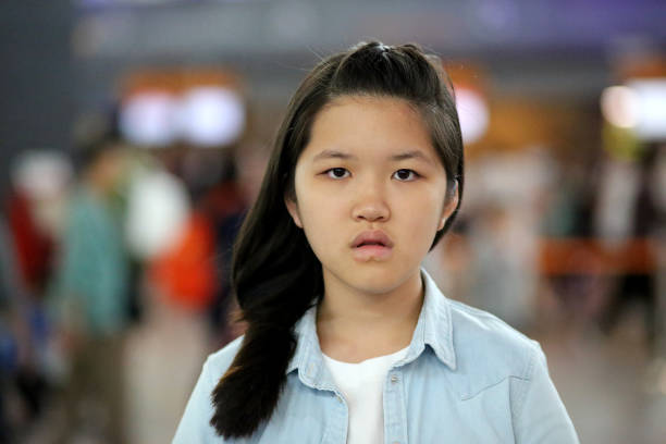 South East Asia: At the Airport Portrait of teenage girl. kuala lumpur airport stock pictures, royalty-free photos & images