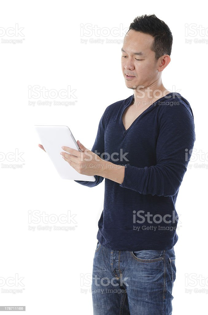 south east asian manwith a tablet in casual royalty-free stock photo