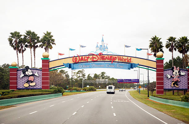 south entrance of disney world in orlando florida - orlando florida photos stock photos and pictures
