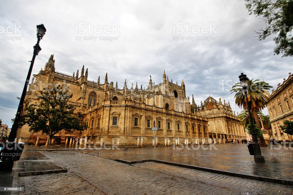 South facade of the Cathedral of Saint Mary of the See (Catedral de Santa Maria de la Sede, or Seville Cathedral) from Constitucion Avenue, Seville (Sevilla), Andalusia, Southern Spain stock photo