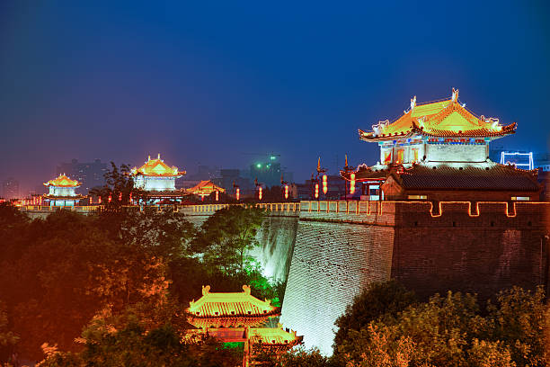 South gate of Xi'An City Wall, China Xi'An City Wall is one of the best and oldest wall in China. It is 14km long, 12m high and 12-14m wide at the top.   silk road stock pictures, royalty-free photos & images