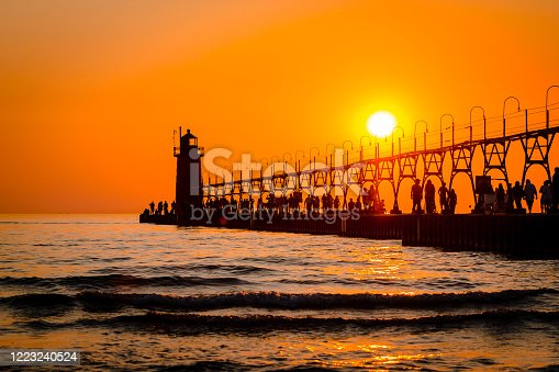 177362898 istock photo South Havens lighthouse and pier during sunset 1223240524