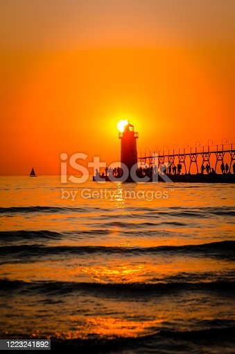 177362898 istock photo South Havens lighthouse and pier on Lake Michigan at sunset 1223241892