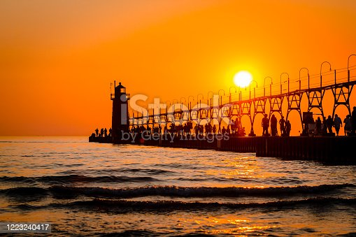 177362898 istock photo South Havens lighthouse and pier on Lake Michigan during sunset 1223240417