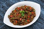 South Indian dish spicy beef fry / meat curry Kerala, India. side dish ghee rice, appam, parotta, puttu, bread and chappathi, Kerala cuisine , Indian food for Ramadan, Ramzan, Eid Christmas, Easter