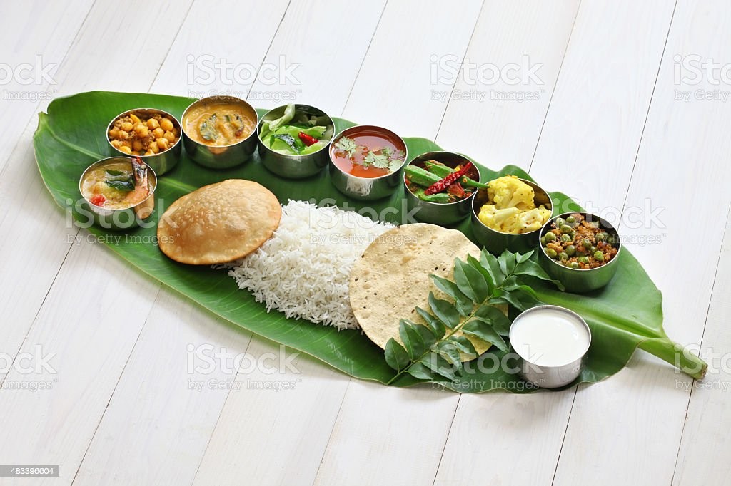 south indian meals on banana leaf stock photo