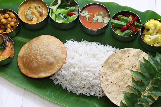 south indian meals on banana leaf - south stock photos and pictures