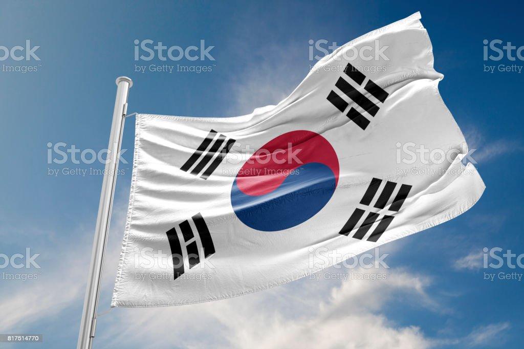 South Korea Flag is Waving Against Blue Sky stock photo