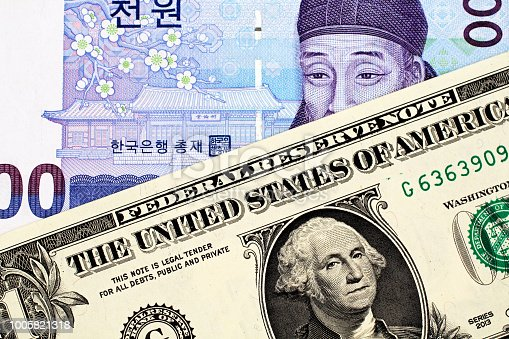A South Korean 1000 won note with an American one dollar bill