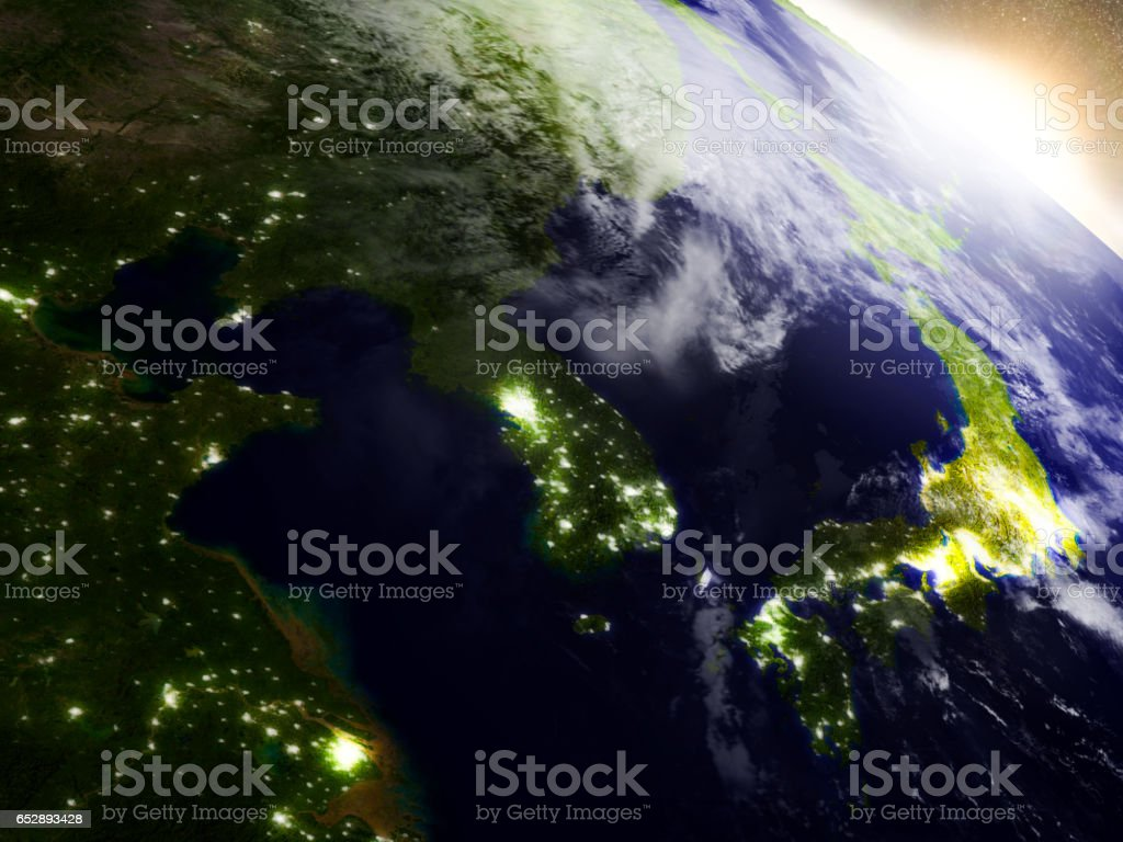 South Korean and North Korea from space during sunrise stock photo