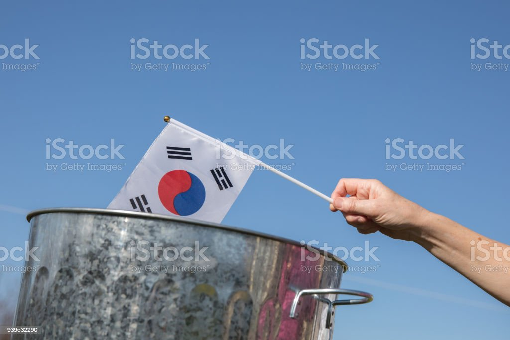 South Korean flag placed into dustbin a troubled finished country? stock photo