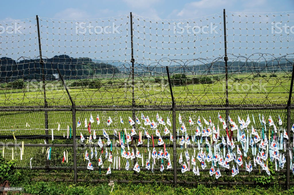 South korean flags at a fence at the demilitarised zone DMZ at the freedom bridge, South Korea, Asia stock photo