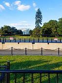 South lawn view of the White House, with security barriers protecting the residence of the president of the United States of America, in Washington, DC.