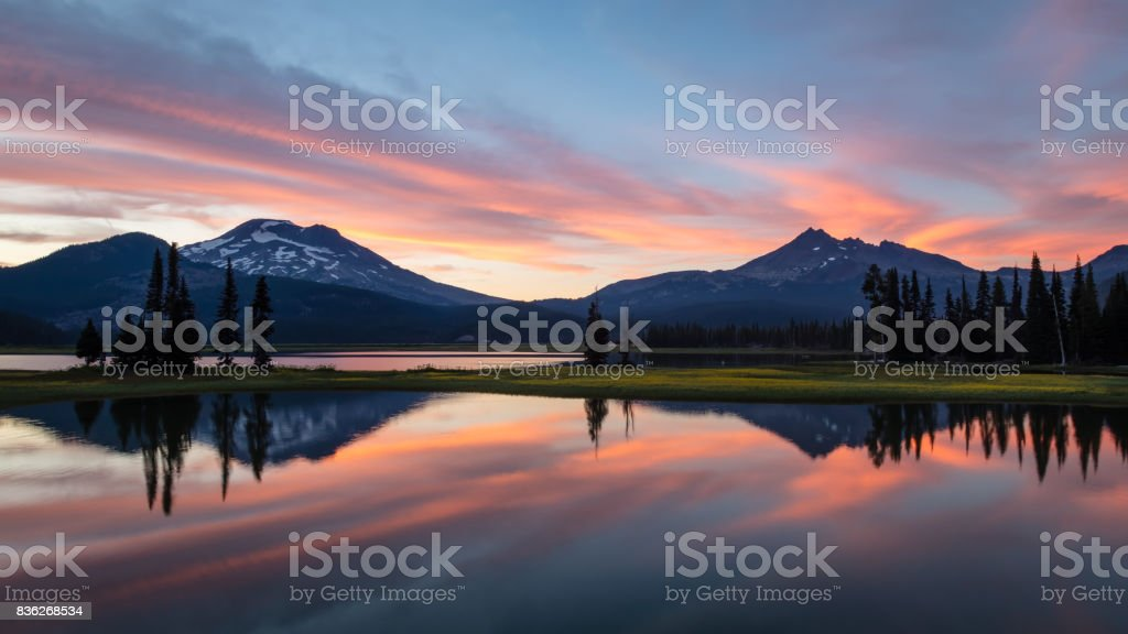 South Sister and Broken Top at Sunset from Sparks Lake, Oregon stock photo