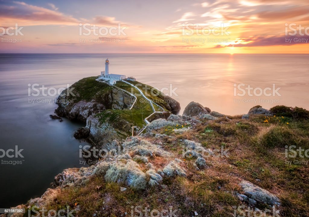 South Stack Lighthouse during sunset stock photo
