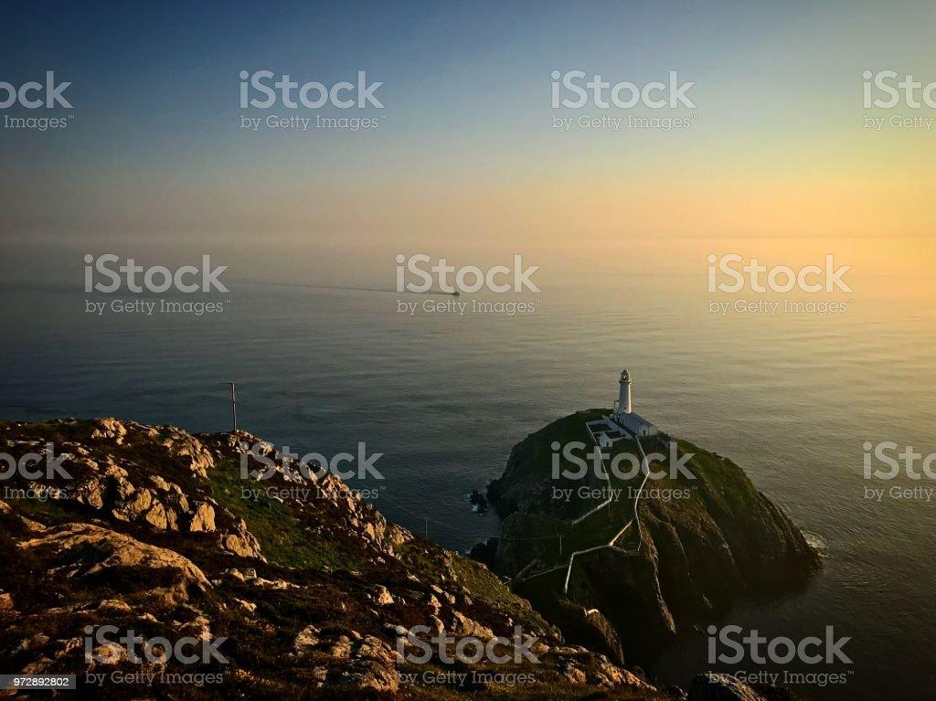 South Stack Lighthouse sunset stock photo